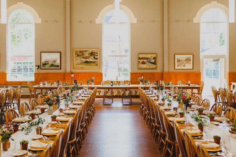 Photo of dining hall arranged for a banquet
