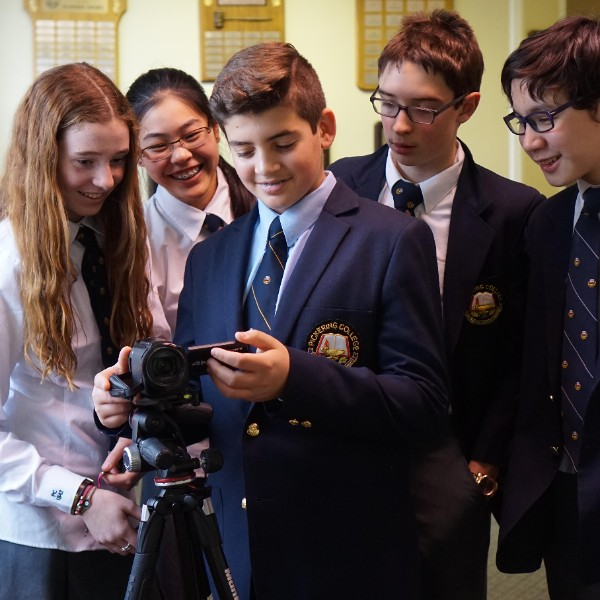Middle School students learning how to use video camera