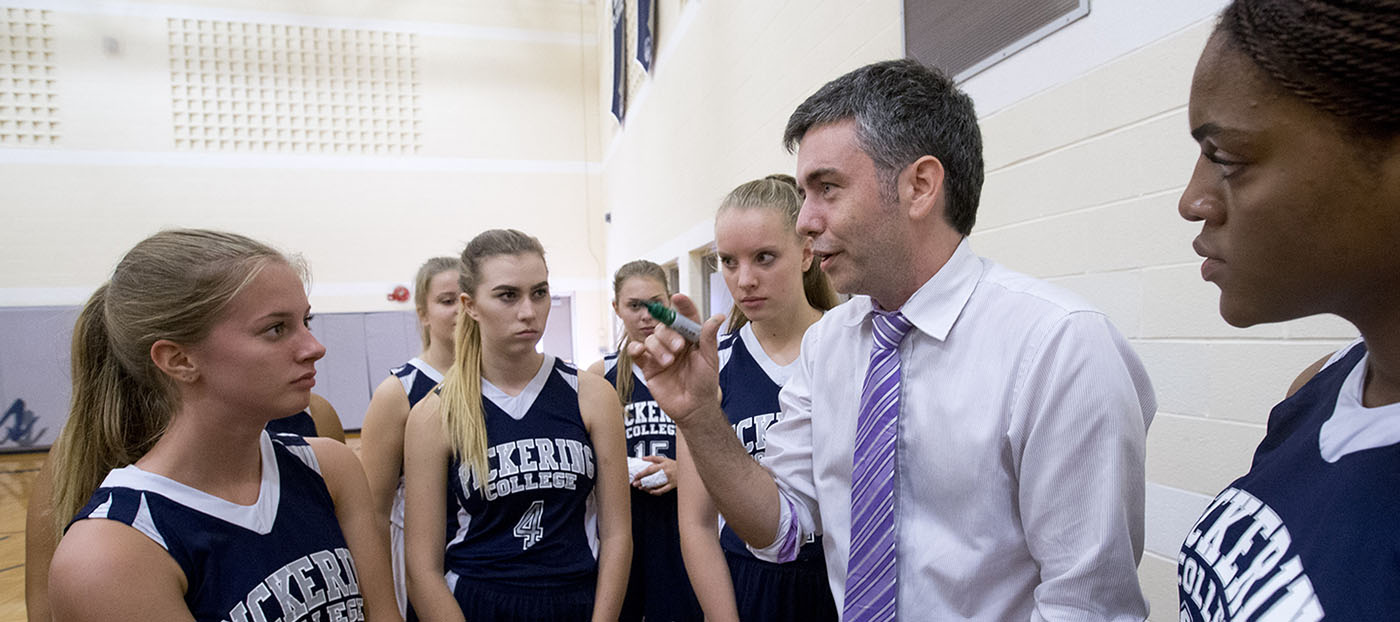 Coach talking with girls team