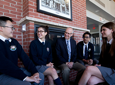 Senior School students having a discussion with Head of School