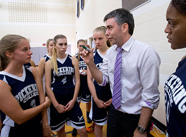Senior Girls' Basketball team with coach