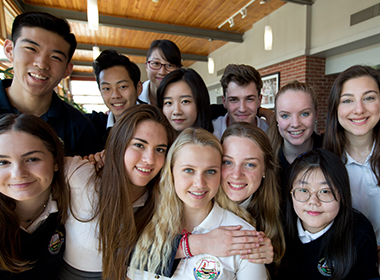 Student life at a top boarding school with Senior School students posing for a photo
