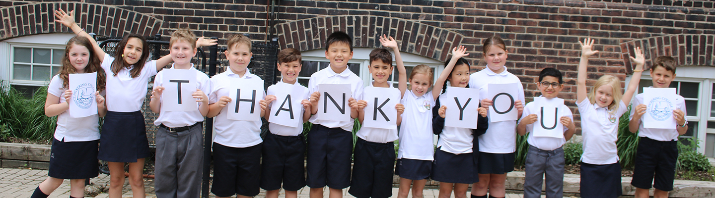 Students holding up 'Thank You' sign